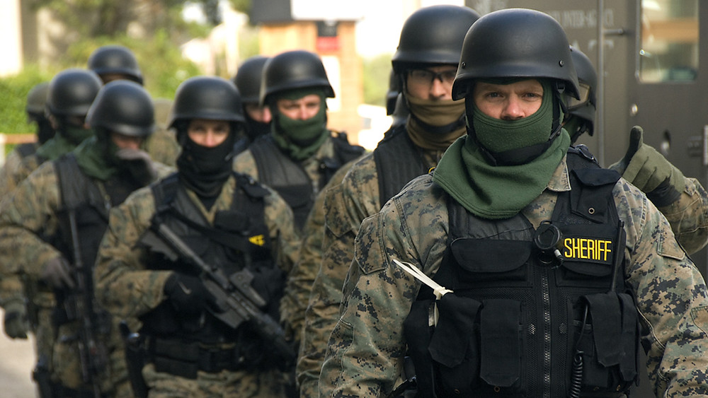 """""""SWAT team prepared"""" by Oregon Department of Transportation is licensed under CC BY 2.0. / Resized and cropped from original"""