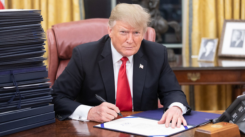 President Trump at his desk.