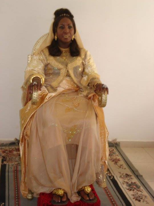 Facebook - Her Imperial Majesty Empress Shebah 'Ra - Queen Shebah III seated on