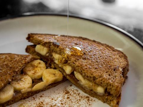Homemade Spiced Peanut Butter, Honey, and Banana Sandwich