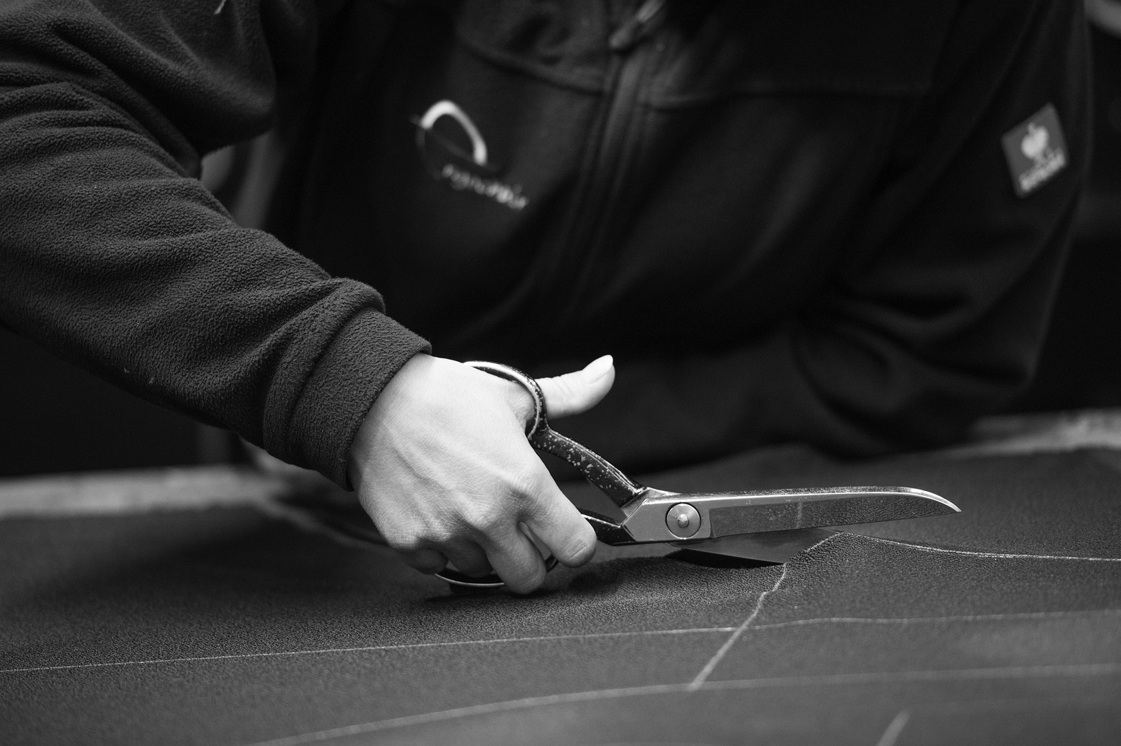 Cutting the cloth accordingly, part of the process in manufacturing a office chair.