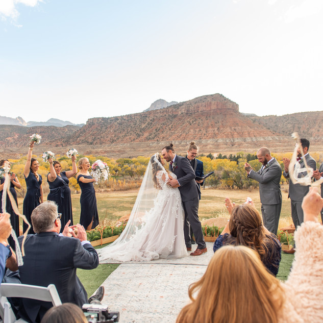 ceremony with mountain backdrop in utah.
