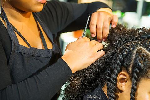 Close up african hairstylist braided hai