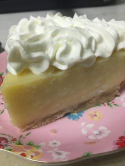 Coconut Cream Slice on decorative plate.