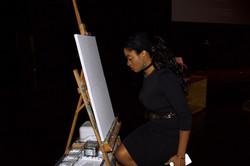 Painting liveat BLMTO's showcase