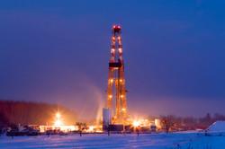 Oil Well In Snowy Landscape