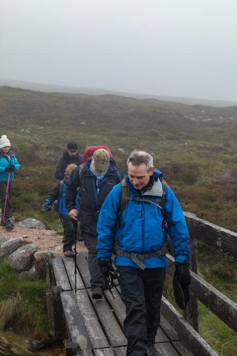 John leading the way down