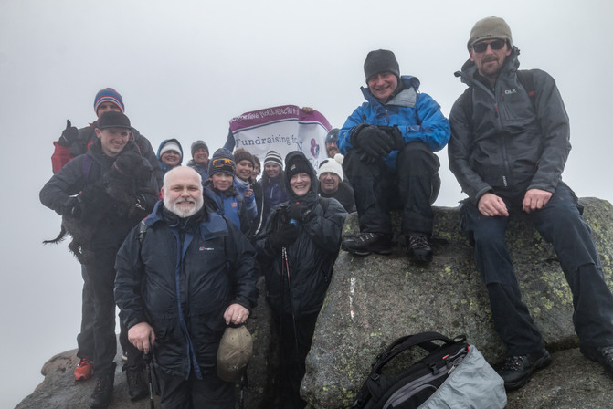 The poor weather meant no photos on the ascent, but we dragged it out for the 'proof of achievement' at the summit, where we ate lunch in the gloom - photo by Jackie from CLAN