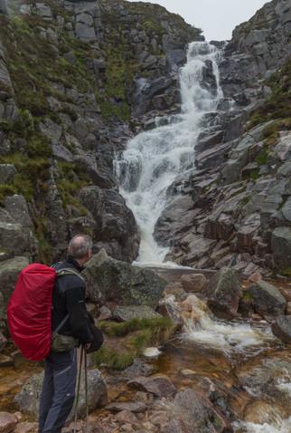 John admires the waterfall