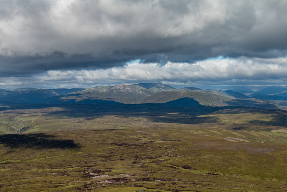 The summit of Mount Keen revealed this view of Lochnagar in the distance, where we would have been headed were it not for the strong winds.  I had to sit down to take this photo, because I couldn't stand up and hold the camera, it was so windy