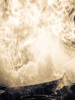 Fire burn is cooking on iron pan,stir fi