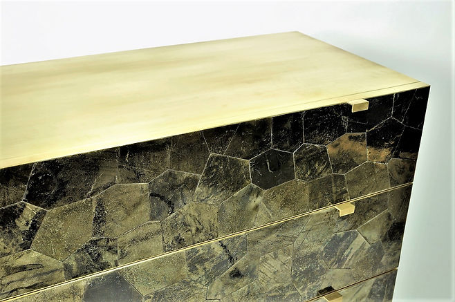 Chest of drawers covered with mica marquetry and brushd brass