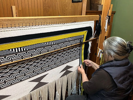 Lani-side-shot-weaving-Generations-Robe-