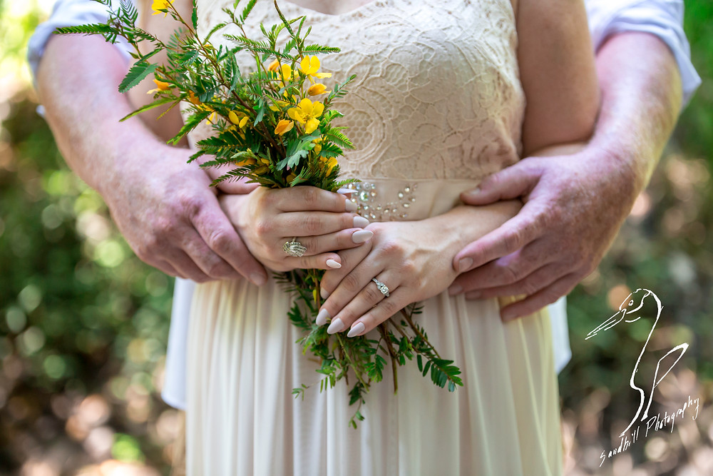 Rye Preserve Engagement Photography, Couple's hands with engagement ring and flowers