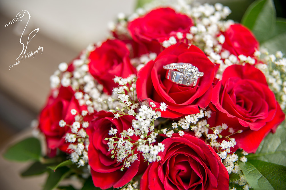 Anna Maria Oyster Bar Wedding Photography Boquet Roses Babies Breath Rings detail picture