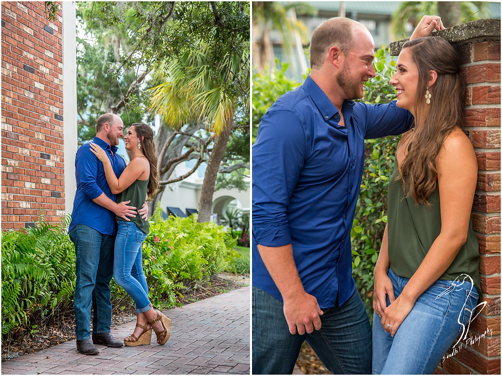 Downtown Bradenton Engagement Photography a man and woman look romantically into each others walls in an urban setting
