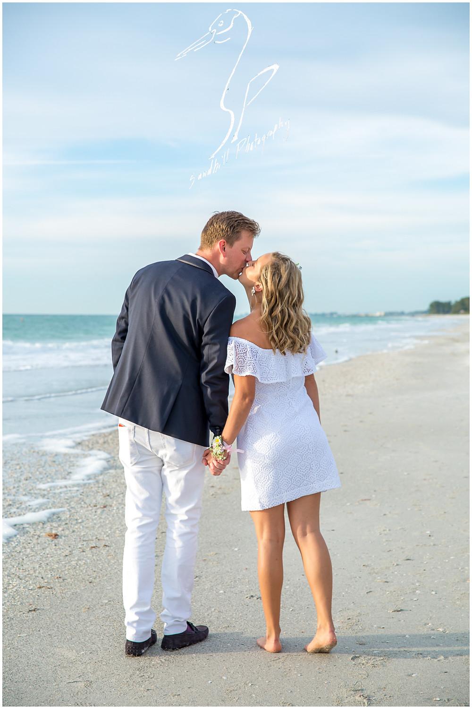 Anna Maria Island Wedding Photography, newlyweds kiss on the beach