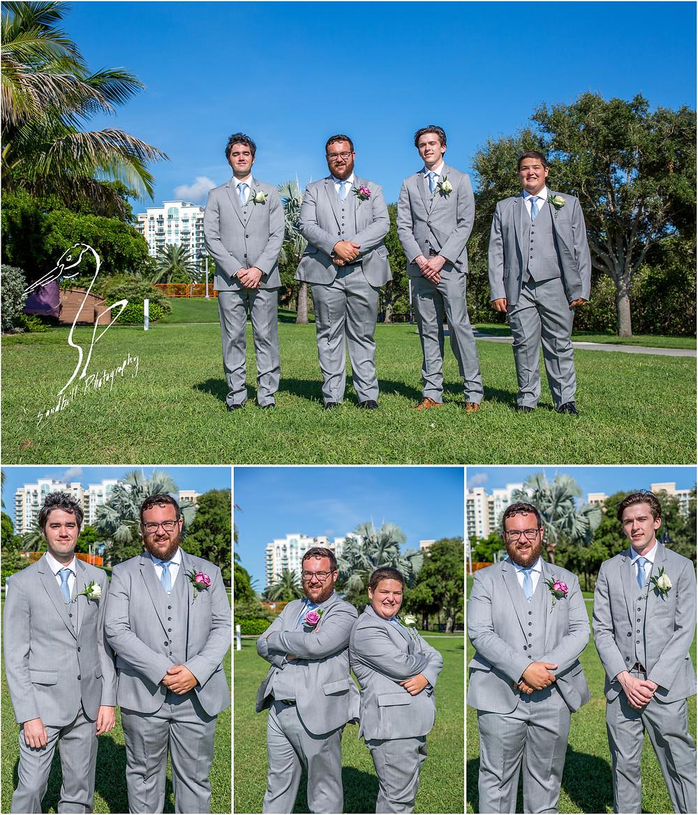Van Wezel Wedding Photography, Groom and Groomsmen standing infront of Downtown Sarasota