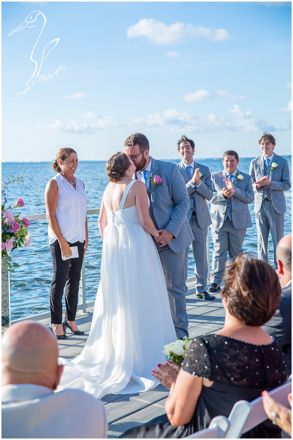 Van Wezel Wedding Photography, During the ceremony, the couple share their first kiss as husband and wife.  Sandhill Photography, Sarasota.