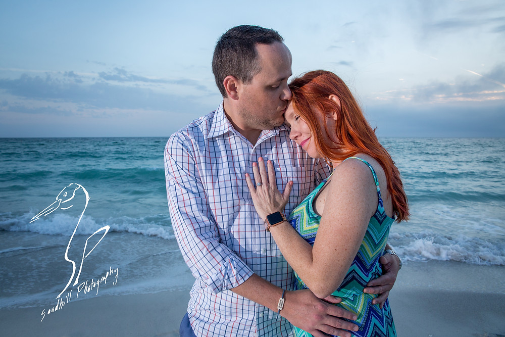 Anna Maria Island Engagement Session Holmes Beach Sunset flash Photography Engagement sand ocean kiss forehead hand on chest chevron dress