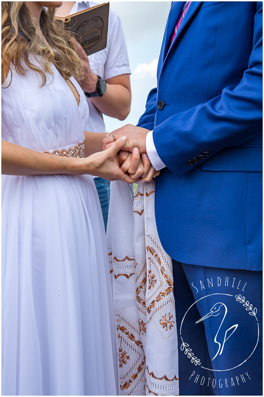 Destination Wedding Photographer, bride and groom clasp hands, image by Sandhill Photography, Bradenton FL