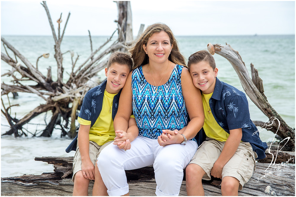 Longboat Key Family Photographer, a mother and her sons relax for a portrait on the beach at Beer Can Island