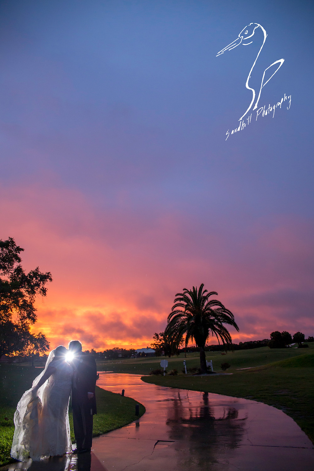 Rainy Day Wedding Photography Sarasota, Backlit photography with starburst on the bride and groom at sunset, Sandhill Photography