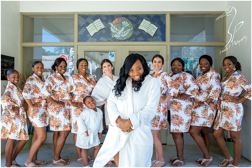 Bradenton Wedding Photographer, Bride and Bridesmaids all wearing matching robes in front of United First Methodist Church of Seffner