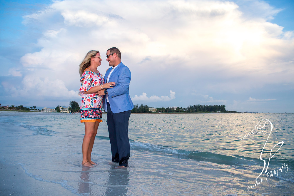 Longboat Key Surprise Proposal, engaged couple standing in the water at the beach gazing at each other