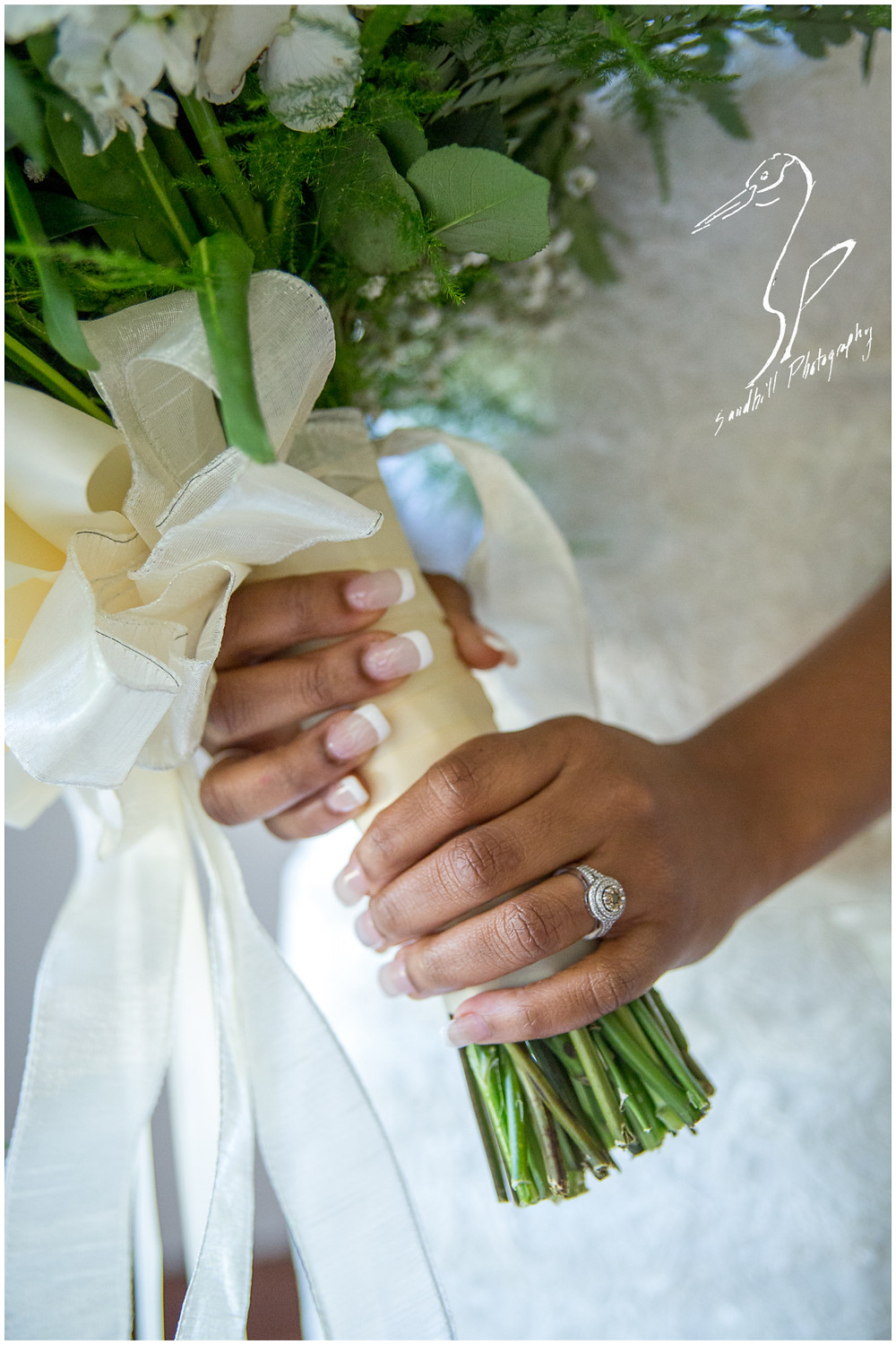Bradenton Wedding Photographer, detail picture of the bride's hands holding her bouquet, focused on her engagement ring, at United First Methodist Church of Seffner