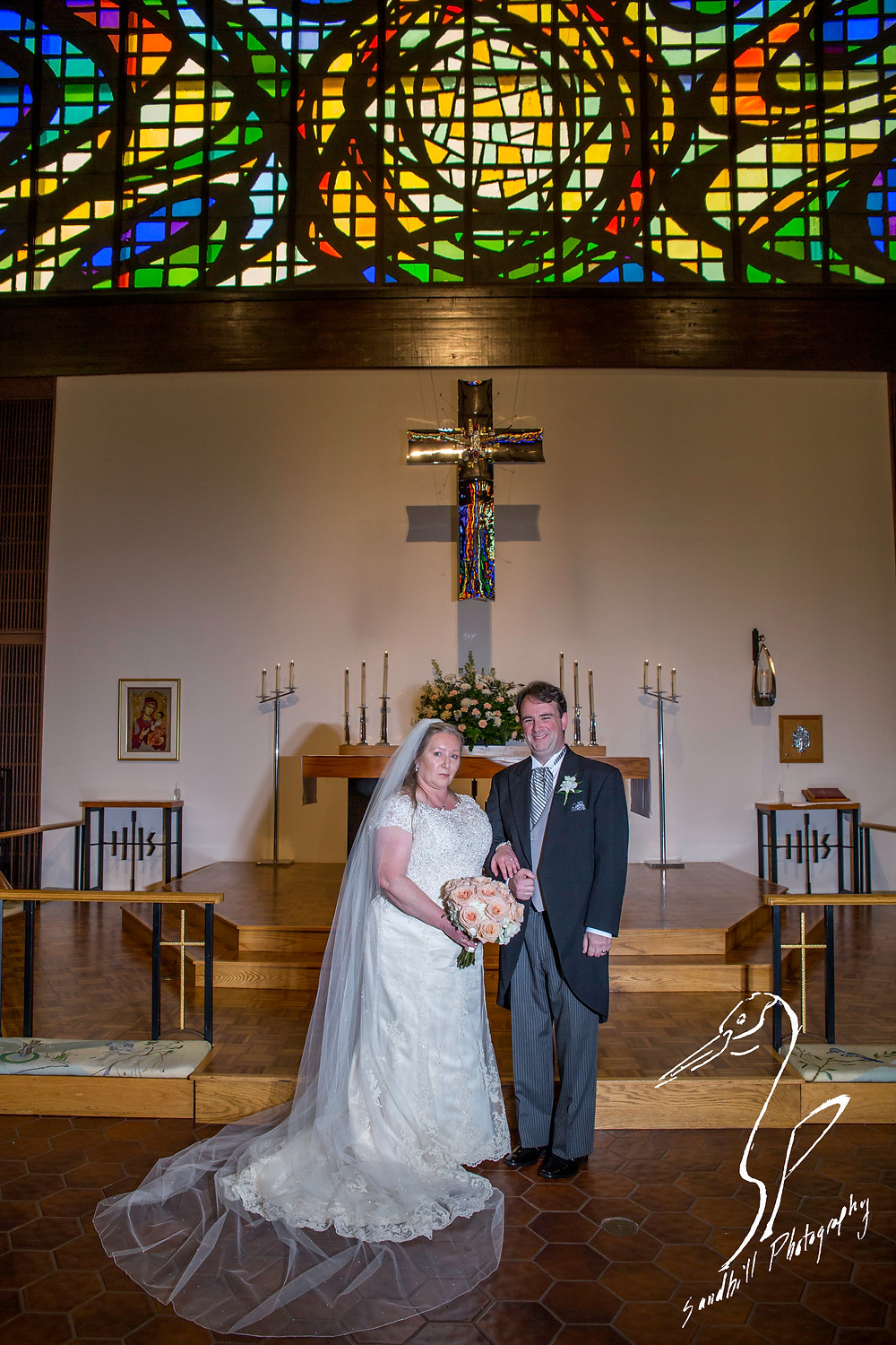 Rainy Day Wedding Photography Sarasota, Wedding Portrait with the Bride and Groom at the alter in St. Boniface Episcopal Church, Siesta Key