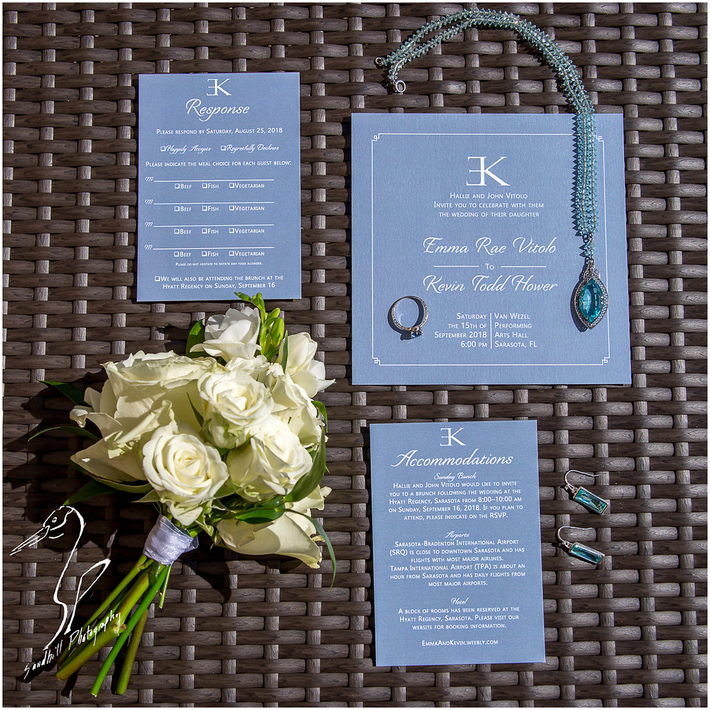 Van Wezel Wedding Photography, detail picture of wedding invitations, bouquet of white roses, and bridal jewelry