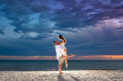 Dramatic sunset engagement photography on Anna Maria Island by Sandhill Photography