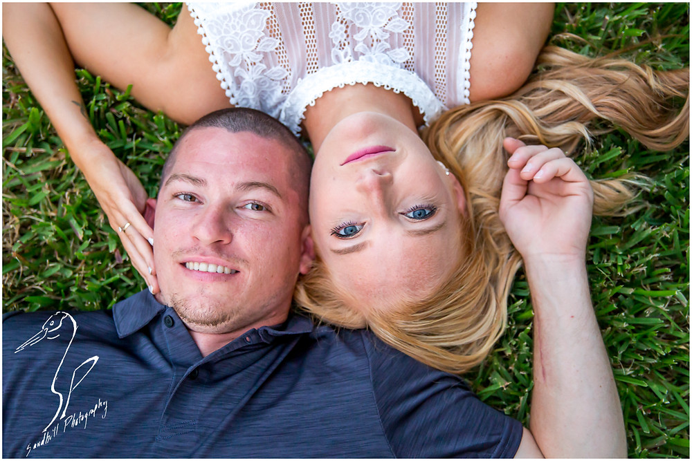 Disney's Grand Floridian Engagement Session, romantic portrait of couple laying in grass, by Sandhill Photograpy