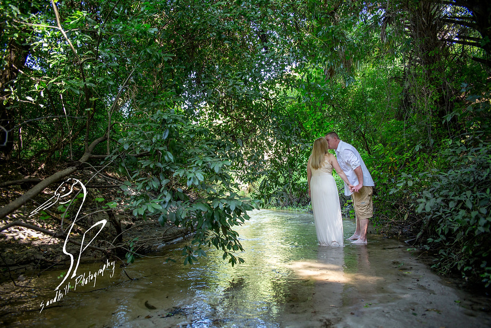 Rye Preserve Engagement Photography, couple kissing standing in a creek in the woods