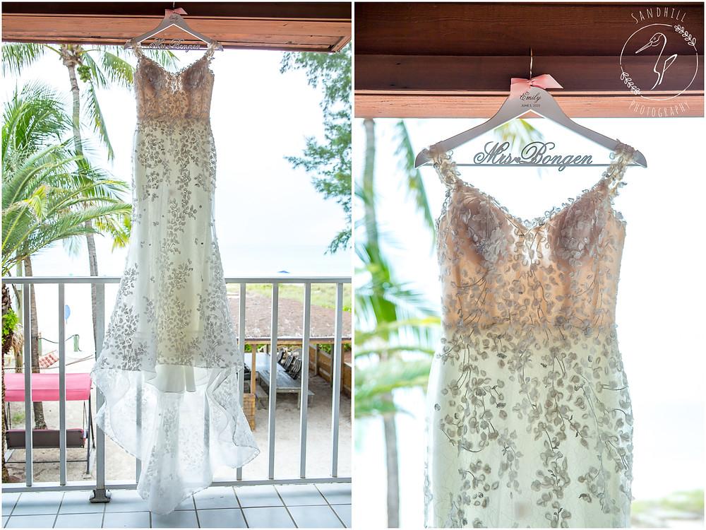Anna Maria Island Wedding Photographer detail picture of wedding dress hung on balcony at Cedar Cove Resort