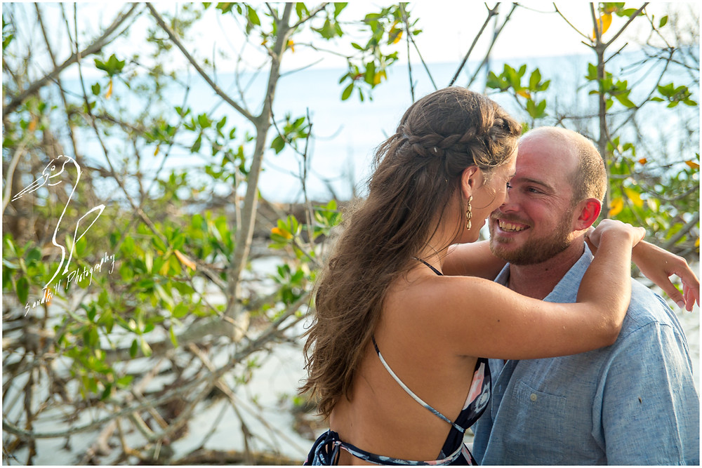Beer Can Island Engagement Photography, couple embracing in the mangroves on Longboat Key
