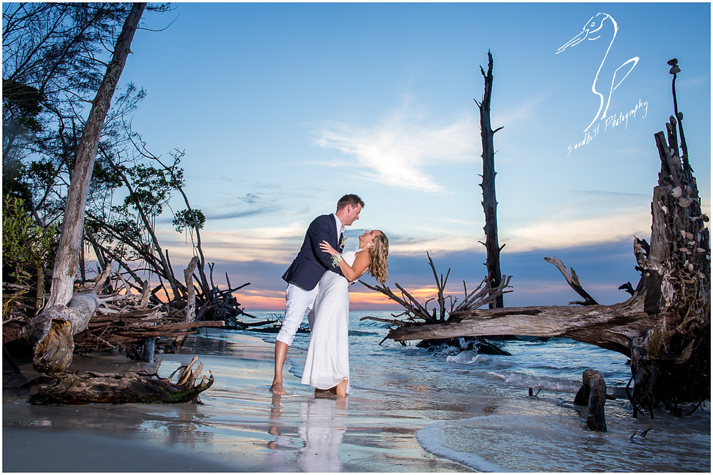 Anna Maria Island Wedding Photography, bride and broom with feet in the water at Beer Can Island