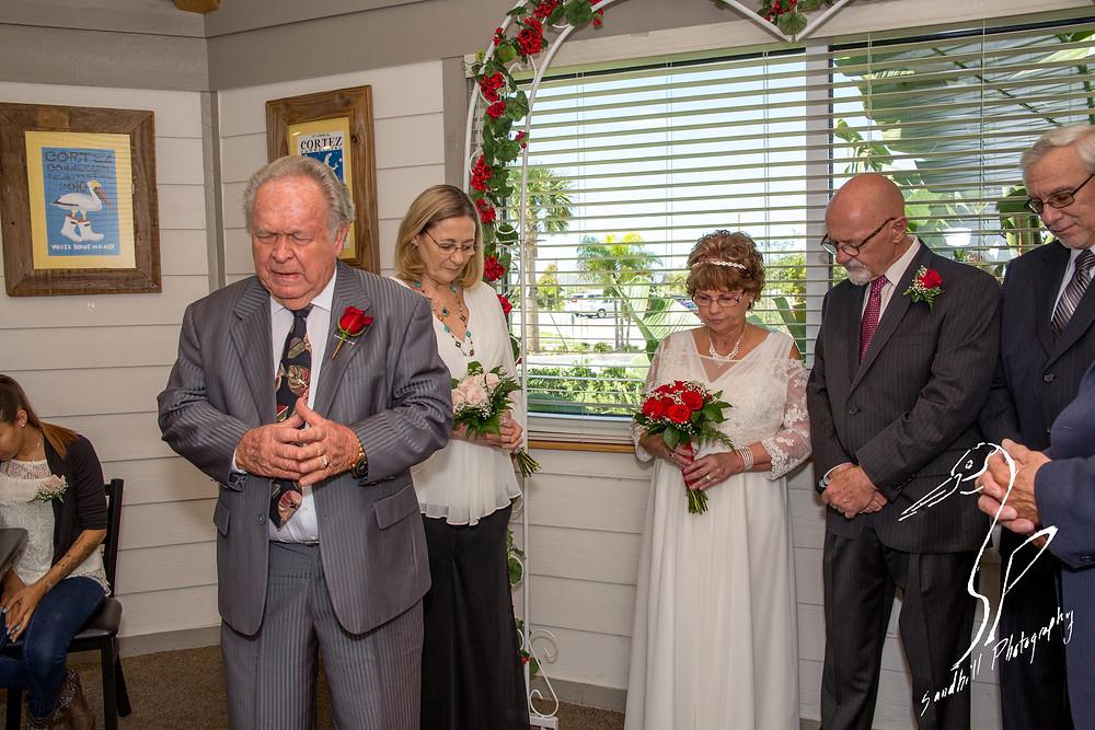 Anna Maria Oyster Bar Wedding Photography Ceremony Bradenton Gospel Tabernacle Pastor Prayer
