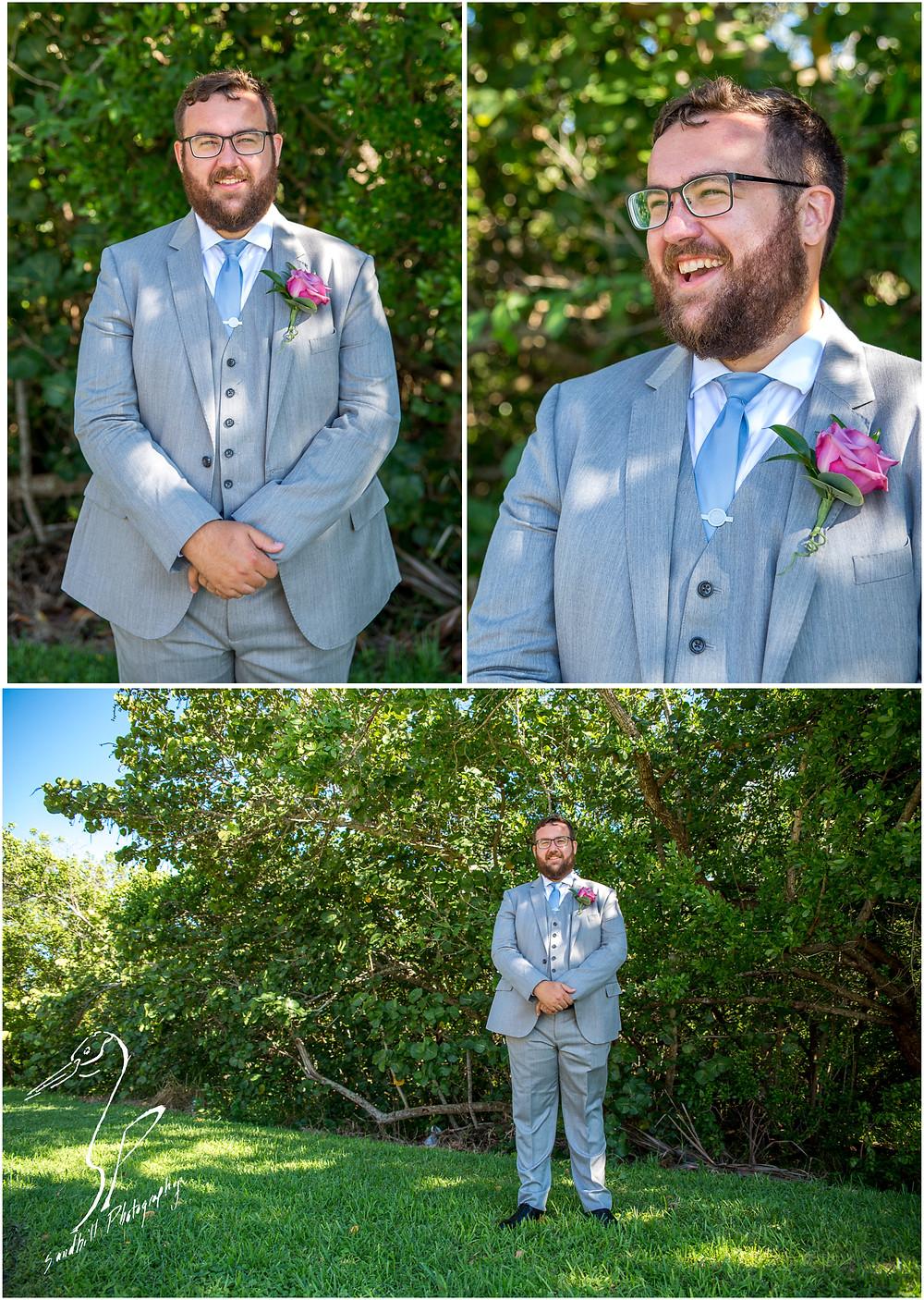Van Wezel Wedding Photography, wedding portraits of the groom standing in front of the trees in Sarasota