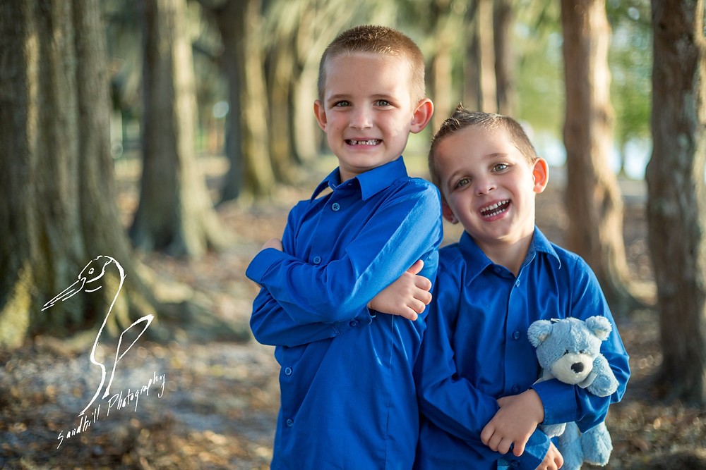 Bradenton Family Photographer | Top 10 tips for Pictures with Kids, brother laughing in the woods