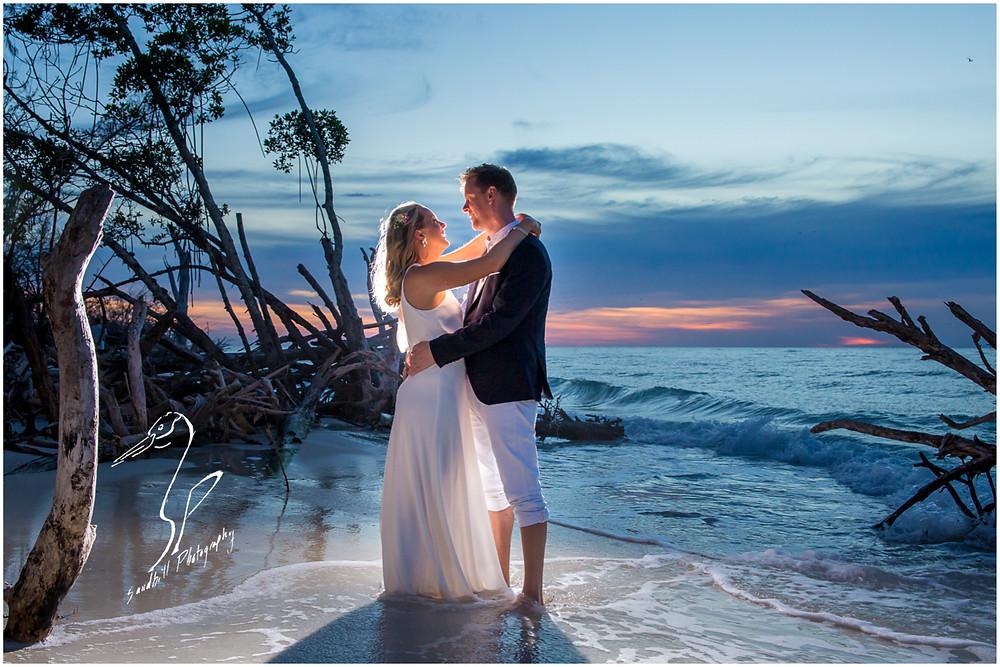 Anna Maria Island Wedding Photography, backlit beach wedding picture