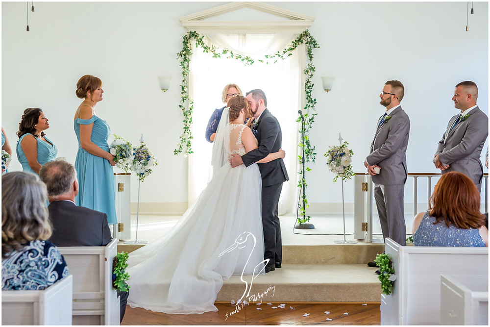 Sarasota Wedding Photography Crocker Memorial Church bride and groom share their first kiss