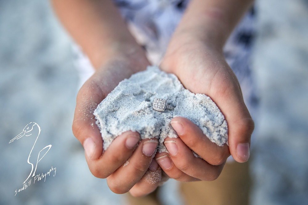 Beer Can Island Sunset Engagement Photography Child's Hands holding ring in sand beach