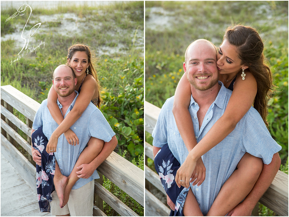 Beer Can Island Engagement Photography romantic image with woman wrapping her arms and legs around her fiance on the beach boardwalk