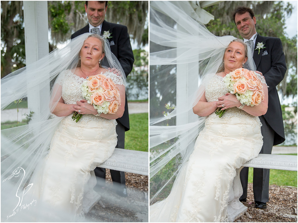 Rainy Day Wedding Photography Sarasota, Wedding portraits of bride and groom with brides cathedral veil flowing in the wind