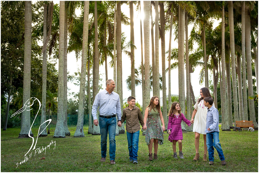 Bradenton Family Photographer | Top 10 tips for Pictures with Kids Family walking in the sunlight