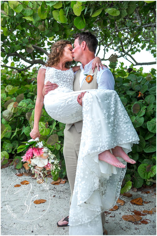 Anna Maria Island Wedding Photographer portrait of bride and groom kissing