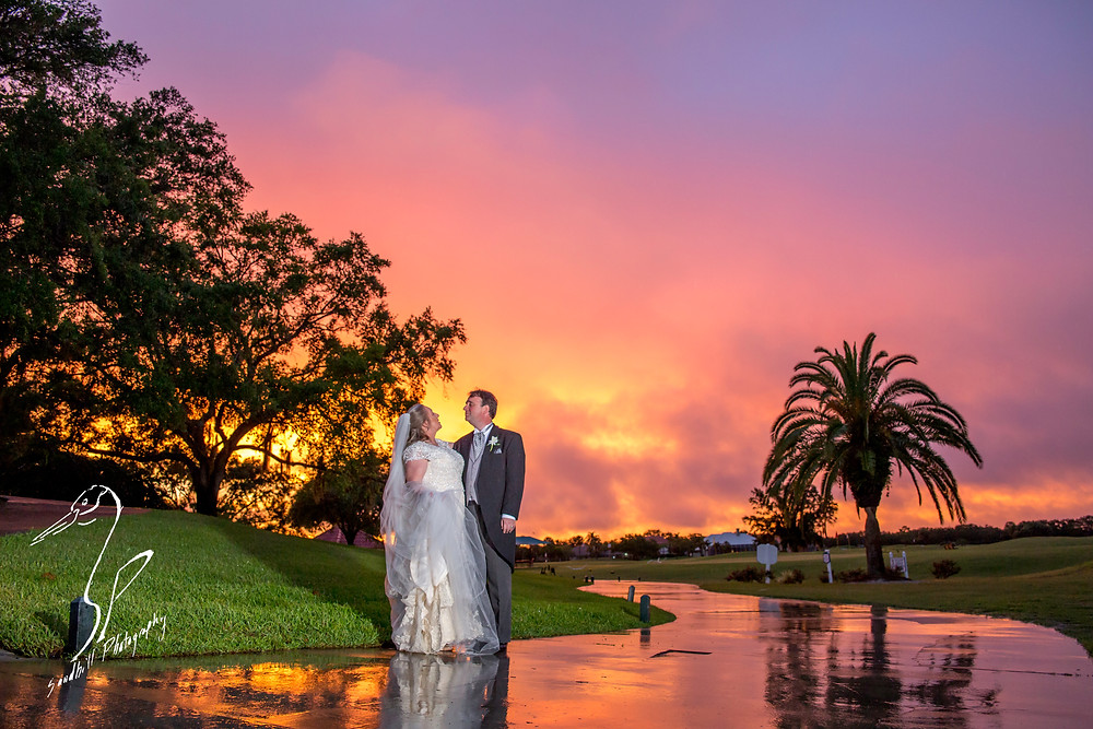 Rainy Day Wedding Photography Sarasota, wedding portraits at sunset with the bride and groom looking at one another, Sandhill Photography