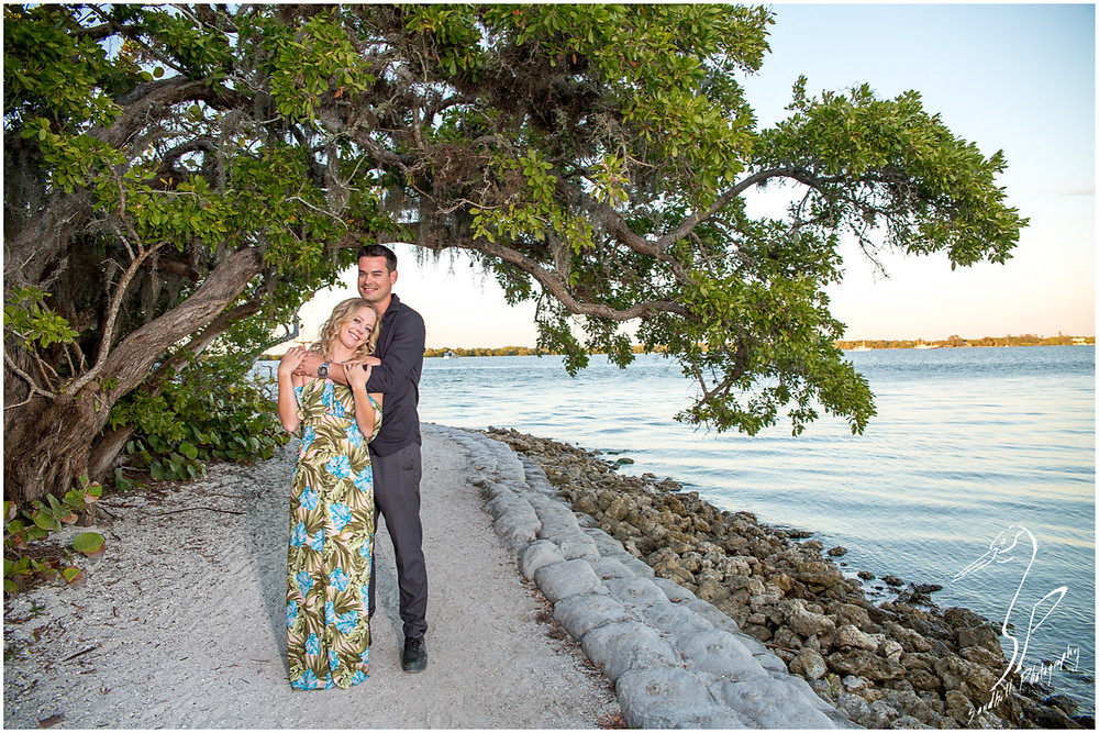 DeSoto National Memorial Photography, a couple embrace beneath a tree on the shore of the Manatee River